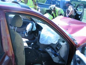 Ambulance staff renders aid at an accident. Airbags deployed.